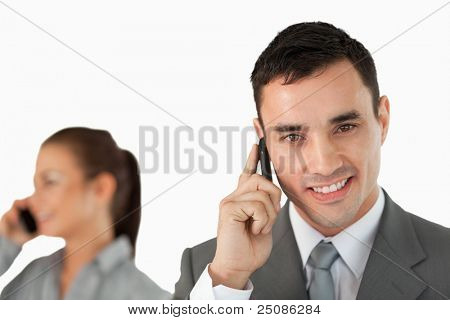 Close up of business partners on the phone against a white background