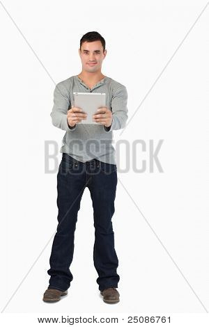 Young male holding his tablet against a white background