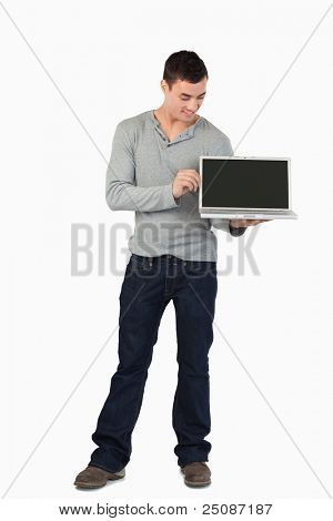 Young male showing his laptop against a white background