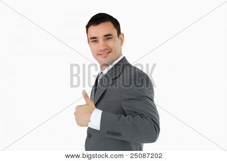 Side view of businessman giving thumb up against a white backgroung