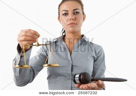 Female lawyer holding scale and gavel against a white background