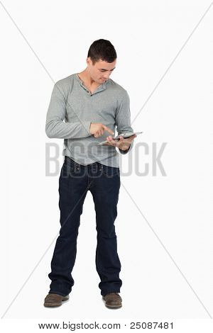 Young male working on his tablet against a white background