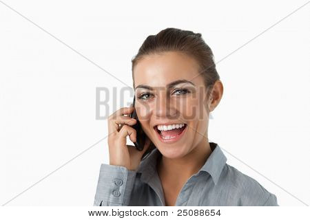 Close up of laughing businesswoman on the phone against a white background