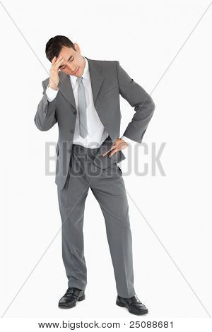 Businessman experiencing a setback against a white background