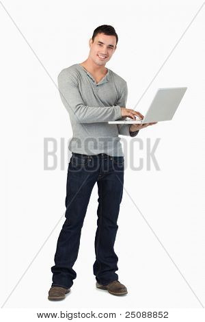 Young male working on his laptop against a white background
