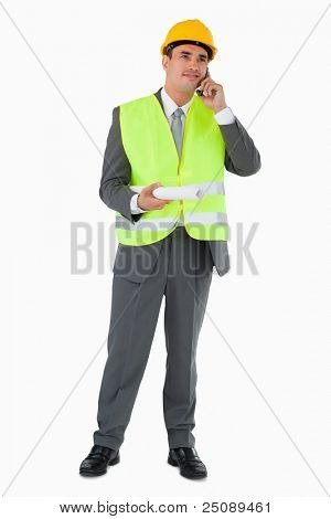 Architect listening to caller against a white background