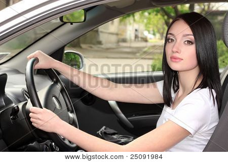 young brunette woman in new car