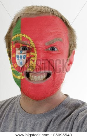 Face Of Crazy Angry Man Painted In Colors Of Portugal Flag