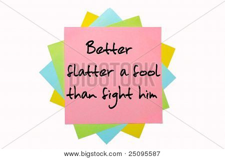 "Proverb ""better Flatter A Fool Than Fight Him"" Written On Bunch Of Sticky Notes"