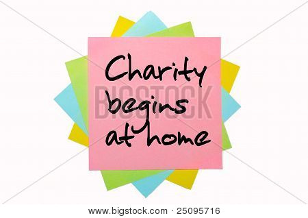 "Proverb ""charity Begins At Home"" Written On Bunch Of Sticky Notes"
