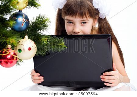 Little Smiling Girl With Laptop Computer