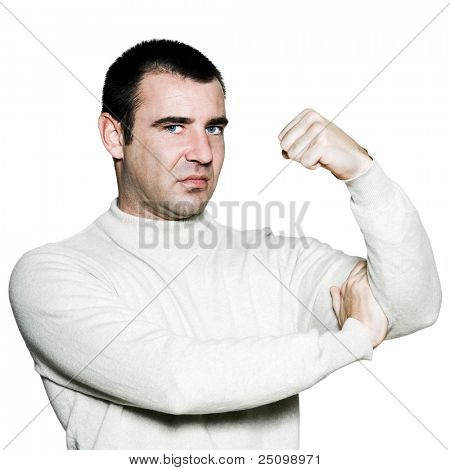 Portrait of a unhappy man flexing biceps in studio on white isolated background