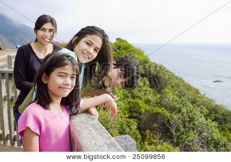 Four Children Along The Ocean Shore