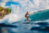 Surf Girl On Surfboard. Woman In Ocean During Surfing. Surfer And Ocean Wave poster