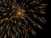 stock photo of gold glitter  - Sparkling spray of fireworks after burst full frame - JPG