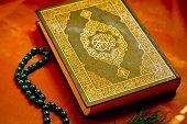 image of rosary  - Muslim Holy Koran book and blue rosary - JPG