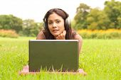 stock photo of young adult  - Young lady with laptop in park - JPG