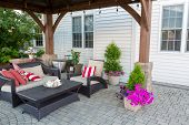 Outdoor Living Space On A Brick Patio With Covered Gazebo And Comfortable Furniture With Colorful St poster