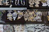 Many Different Woman Jewellery And Accessory On Display: Bracelets, Earing, Necklaces, Rings poster