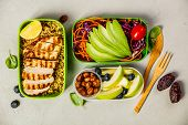 Healthy Meal Prep Containers: Couscous With Grilled Chicken Breast, Salad, Avocado, Berry, Apple, Nu poster