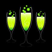 stock photo of champagne glass  - Three green alcoholic cocktails - JPG