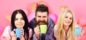 Threesome Relax In Morning With Coffee. Lovers Concept. Man And Women, Friends On Smiling Faces Lay, poster
