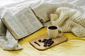 Morning Coffee With Bible Illuminated By Sunlight. Cup Of Coffee With Christian Bible. White Bedroom poster