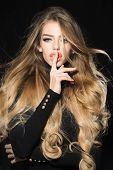 Model With Long Blonde Waving Hair Wearing In Black Golf Show Shh Sign. Gorgeous Long Hair. Haircare poster