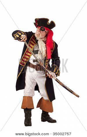 Classic Pirate Captain In Authentic Looking Costume, Standing And Drawing His Sword.