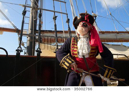 Smiling Pirate With Pirate Ship