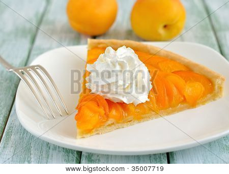 Apricot tart with whipped cream