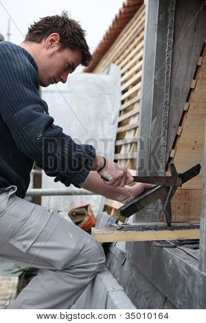 Roofer working with slate