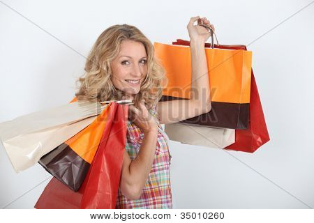 A smiling woman who enjoyed a shopping spree.