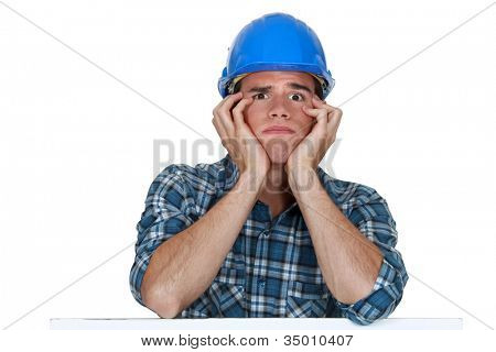 Head and shoulders of a young construction worker