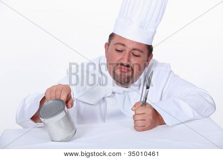 Chef poking tin can