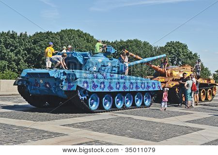 Children Plays On Old War Tanks