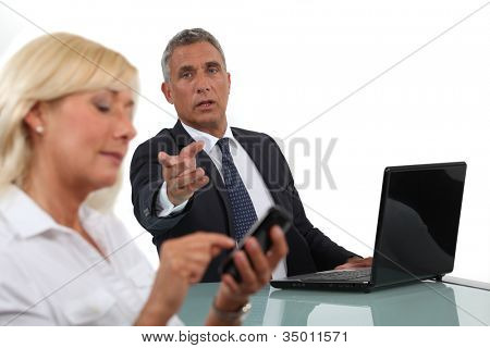 Businessman criticising his colleague