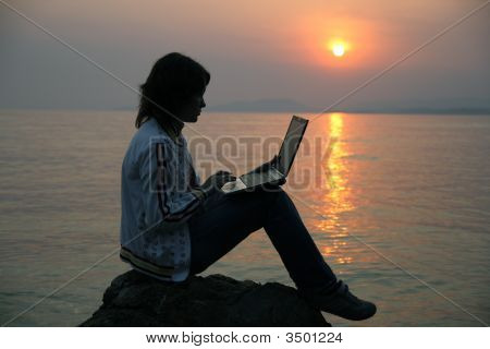The Girl With Notebook And A Decline On The Sea