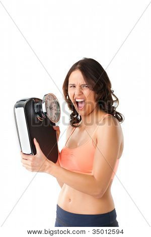 Diet and weight, young woman with a scale, she is desperate and shouting