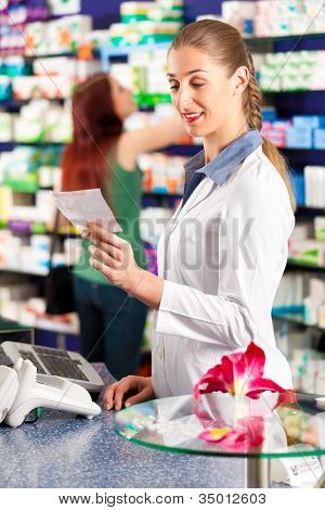 Female pharmacist in her pharmacy with a client