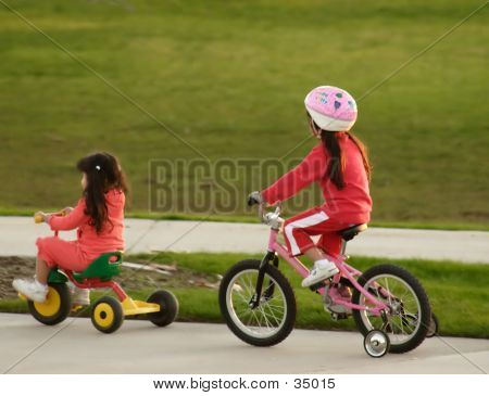 Family Sisters Bicycle Riding