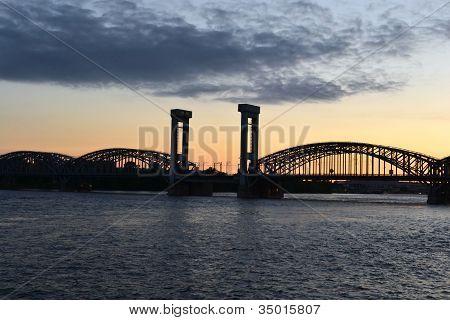 Neva river and Finnish railway bridge at sunset