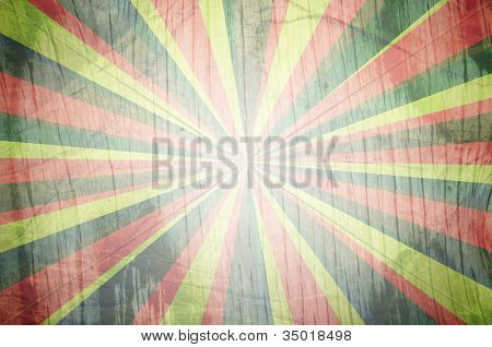 colorful sunbeams grunge background with ribbon. A vintage poster. Useful as background.