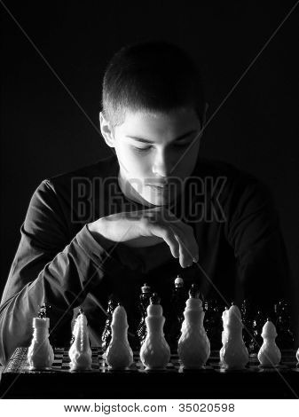 Teenage Boy Playing Chess