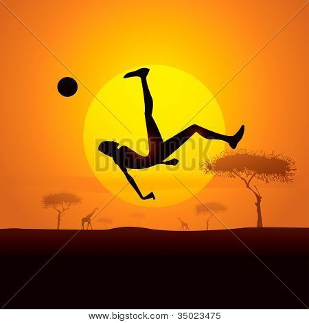 Africa champion kick.  Silhouette of soccer player kicking ball in africa sunset background.