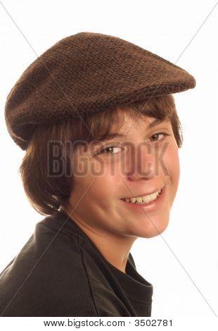 Young Teen Boy Wearing Flat Cap