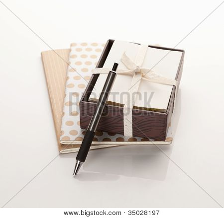 Paper notebooks with box of cards