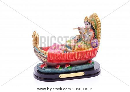 Krishna y Rhada tocando flauta