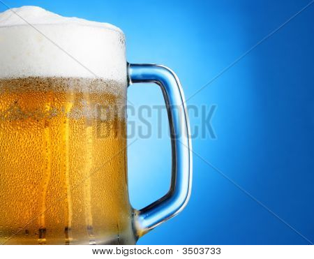 Mug Of Beer Over Blue