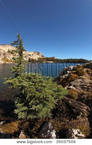 Early clear autumn morning. Stony coast of lake in mountains of national park Yosemite